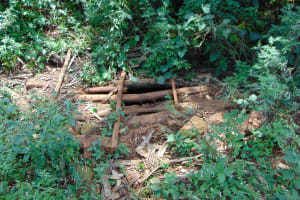 The Water Project: Munenga Community, Francis Were Spring -  Open Pit Latrine