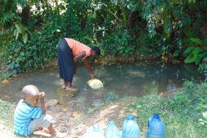 The Water Project: Bukhaywa Community, Ashikhanga Spring -  Waiting While Filling Up