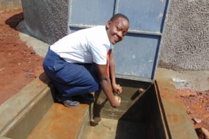 The Water Project: Ikumba Secondary School -  Student Getting A Drink