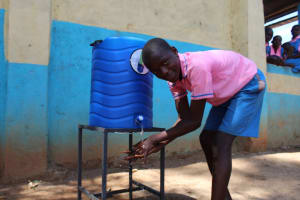 The Water Project: Irovo Orphanage Academy -  Student Washes His Hands