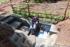 The Water Project: Buhayi Community, Nasichundukha Spring -  Field Officer Jemmimah Feels The Fresh Water