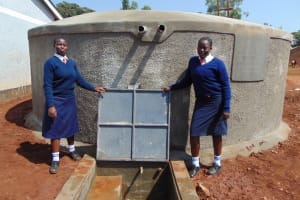 The Water Project: Ikumba Secondary School -  Girls At The Tank