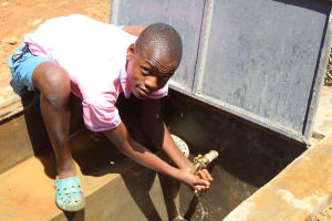 The Water Project: Irovo Orphanage Academy -  Boy At Rain Tank