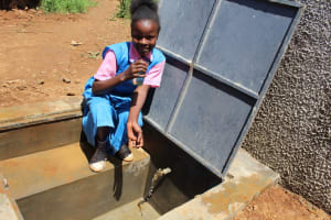 The Water Project: Irovo Orphanage Academy -  Student Gets A Drink