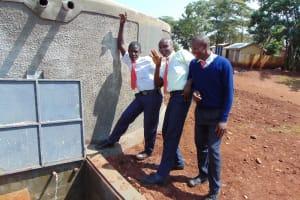The Water Project: Ikumba Secondary School -  Boys At The Rain Tank