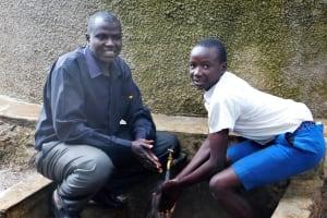 The Water Project: Rabuor Primary School -  Deputy Head Teacher Godfrey Ochieng With Student