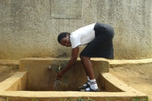 The Water Project: Essong'olo Secondary School -  Student At The Rain Tank