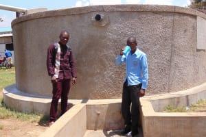 The Water Project: Joyland Special Secondary School -  Field Officer Samuel Samidi With Student Solomon Otieno