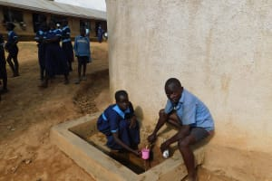 The Water Project: Kenneth Marende Primary School -  Students Get A Drink From The Rain Tank