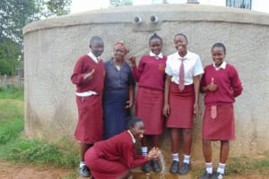 The Water Project: Shikhondi Girls Secondary School -  Mrs Ayodi And Students At The Rain Tnak
