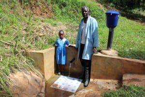 The Water Project: Jivovoli Community, Gideon Asonga Spring -  Samuel With Natasha Lungaso