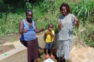 The Water Project: Mwituwa Community, Nanjira Spring -  Grace Brevin And Field Officer Lillian Achieng