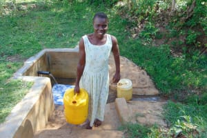 The Water Project: Mbande Community, Handa Spring -  Woman Carrying Water
