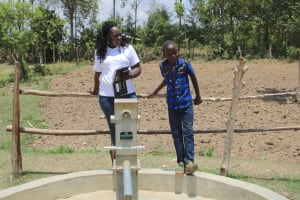 The Water Project: Vilongo Community -  Brian With Field Officer Terry At The Well
