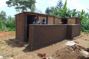 The Water Project: Irovo Orphanage Academy -  Working On Latrine Walls