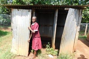 The Water Project: Ebukhuliti Primary School -  Girl Closes Latrine Door