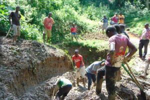 The Water Project: Shamiloli Community, Kwasasala Spring -  Community Members Excavating The Site For Construction