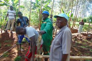 The Water Project: Buhayi Community, Nasichundukha Spring -  Artisans Chatting With Community Members
