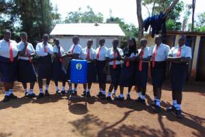 The Water Project: Ikumba Secondary School -  Girls Pose With Handwashing Station