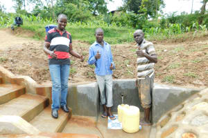 The Water Project: Shihingo Community, Inzuka Spring -  Field Officer Jonathan With Community Members