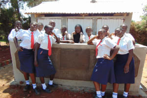 The Water Project: Ikumba Secondary School -  Girls Pose With New Latrines