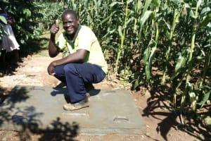 The Water Project: Buhayi Community, Nasichundukha Spring -  Proud New Owner Of A Sanitation Platform