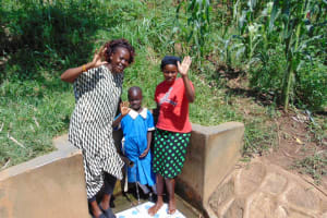 The Water Project: Mwituwa Community, Shikunyi Spring -  Field Officer Lillian Achieng With Christine And Margaret