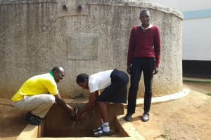 The Water Project: Essong'olo Secondary School -  Asenga Left And Enos Right With Student