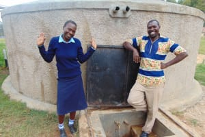 The Water Project: Kamuluguywa Secondary School -  Rebecca And Mr Nambisia At The Rain Tank