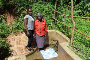The Water Project: Jivovoli Community, Wamunala Spring -  Beatrice With Field Officer Laura Alulu