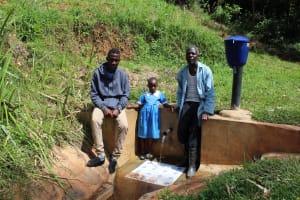 The Water Project: Jivovoli Community, Gideon Asonga Spring -  Field Officer Ian Nakitare With Samuel And Natasha