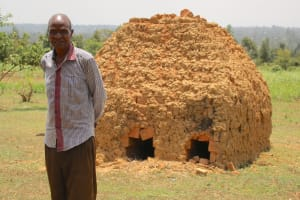 The Water Project: Vilongo Community -  Moses In Front Of Bricks Being Burned Before Use