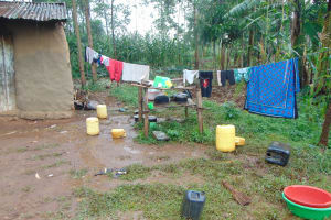 The Water Project: Namarambi Community, Iddi Spring -  Clothes And Dishes Drying