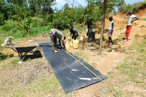 The Water Project: Shihingo Community, Inzuka Spring -  Girls Delivering Water