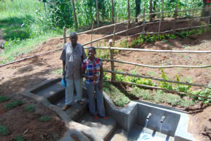 The Water Project: Buhayi Community, Nasichundukha Spring -  Spring Landowner Joseph Sifuna Wekesa And Field Officer Jemmimah