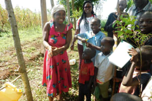 The Water Project: Mutao Community, Kenya Spring -  Washing Hands Using The Leaky Tin