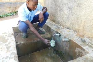 The Water Project: Muyere Secondary School -  Alvine Kakai Gets A Drink