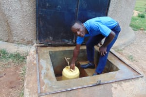 The Water Project: Kamuluguywa Secondary School -  Student Fetches Water From The Rain Tank