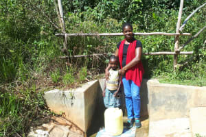 The Water Project: Elukani Community, Ongari Spring -  Dorine With Field Officer Christine Masinde