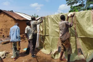The Water Project: Irovo Orphanage Academy -  Passing Materials Over Tank Stucture