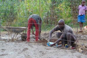 The Water Project: Kapchorwa Primary School -  Arranging Tanks Rebar Perimeter