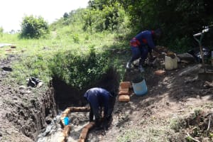 The Water Project: Eshikhugula Community, Shaban Opuka Spring -  Bricklaying Begins