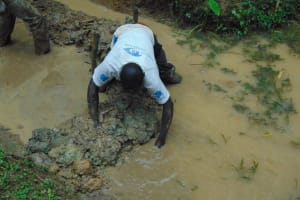 The Water Project: Shamiloli Community, Kwasasala Spring -  Diverting Water From Source For Construction