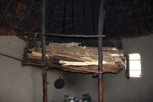 The Water Project: Kalenda B Community, Lumbasi Spring -  Firewood Drying Above Stove