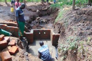 The Water Project: Buhayi Community, Nasichundukha Spring -  Brickwork Begins