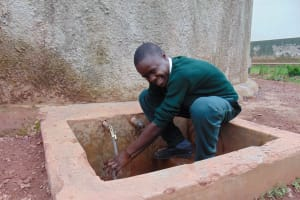 The Water Project: Kwirenyi Secondary School -  Student At Rain Tank
