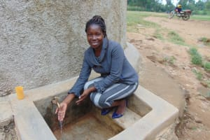 The Water Project: Eshiamboko Primary School -  Field Officer Christine Masinde At The Rain Tank