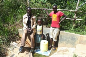 The Water Project: Elukani Community, Ongari Spring -  Community Member With Dorine And Kevin