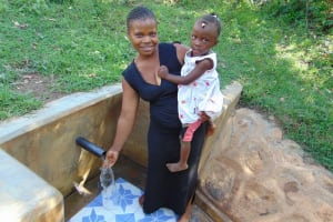 The Water Project: Mbande Community, Handa Spring -  Woman With Her Child At The Spring