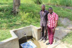 The Water Project: Indete Community, Udi Spring -  Communtiy Member With Jonathan At The Spring